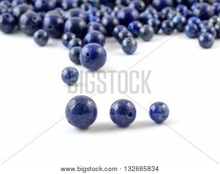 Gemstone natural lapis lazuli on white background, beads.