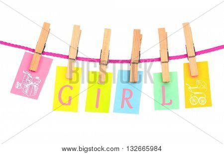 Colorful word hang on rope by wooden peg isolated on white. Baby concept