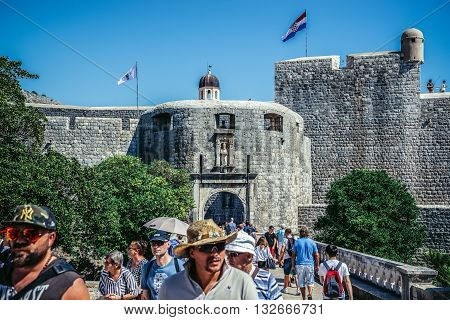 Dubrovnik Croatia - August 26 2015. Tourists on the bridge in front of Pile Gate main entry to the Old Town of Dubrovnik