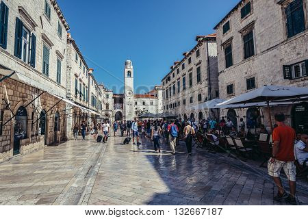 Dubrovnik Croatia - August 26 2015. Tourists walks at main street of Old Town in Dubrovnik called Stradun with Bell Tower on the background