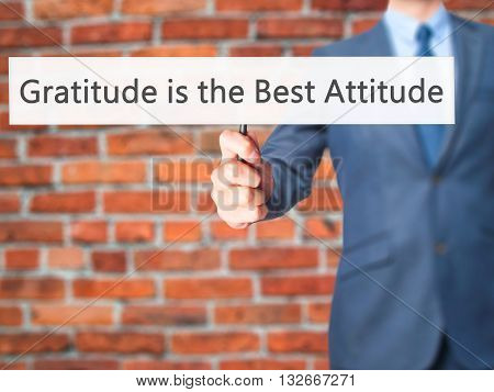 Gratitude Is The Best Attitude - Businessman Hand Holding Sign