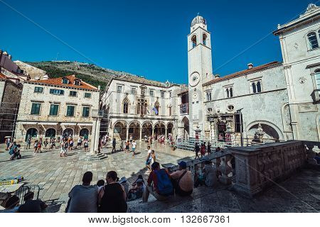 Dubrovnik Croatia - August 26 2015. Tourists on Luza Square on the Old Town of Dubrovnik. View with Sponza Palace and bell tower