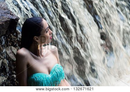 fashion woman in a swimsuit on waterfall