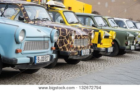 BERLIN GERMANY- January 19 2016: Colourfull vintage small cars for rent by tourists to travell around Berlin.