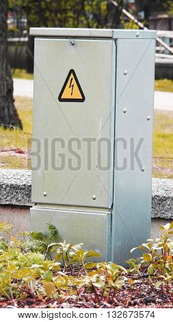 Electricity box. Dangerous box in city park.