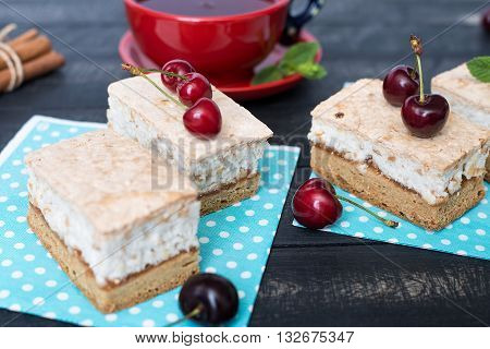 Tea Party with meringue cake and cherries