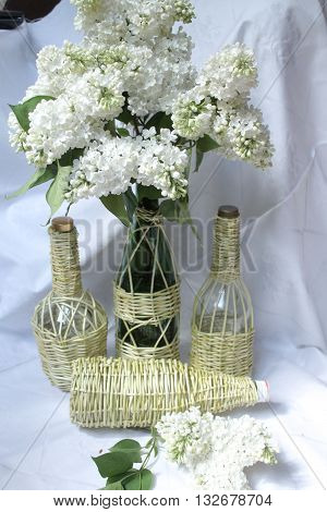 things made wickerwork with pompous bouquet of white lilac goods for decoration home