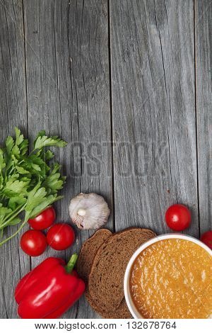Fresh Tomatoes Soup With Vegetables On A Wooden Table.  Viewed From Above. Empty Space For Text