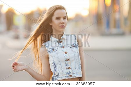 Portrait Of Young Smiling Beautiful Woman. Portrait of a fresh and beautiful young fashion model posing outdoor in sunny weather. woman portrait. smiling girl in city street