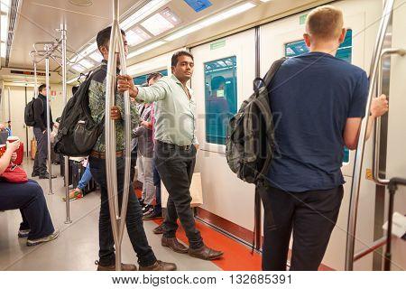 DUBAI, UAE - MARCH 09, 2016: passengers in the train at Dubai International Airport. Dubai International Airport is the primary airport serving Dubai, United Arab Emirates