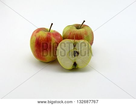 red apple halved on a white background