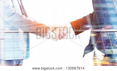 Closeup of businessmen shaking hands on glass building background. Double exposure