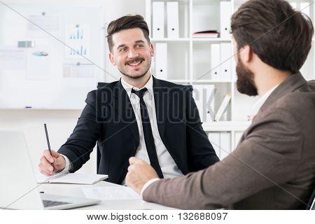 Bearded Businessmen Discussing Something