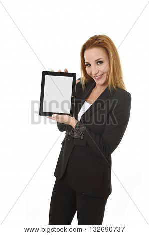 blond beautiful businesswoman holding digital tablet pad showing blank copy space screen wearing suit smiling happy and confident isolated on white background