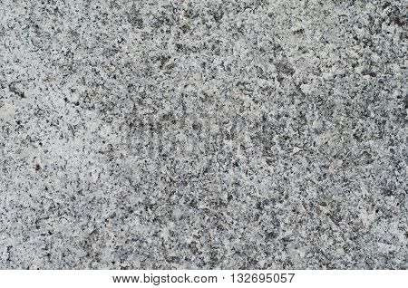 Texture of unpolished gray granite surface background
