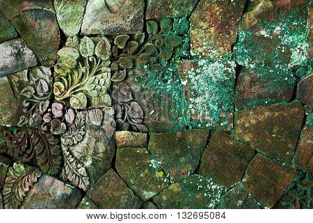 rought stone background with floral colorful pattern for interesting design
