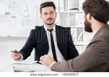 Handsome Businessmen Discussing Something