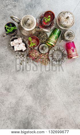 Tea with mint leaves and traditional turkish delight. Oriental hospitality arabic food concept. Ramadan kareem