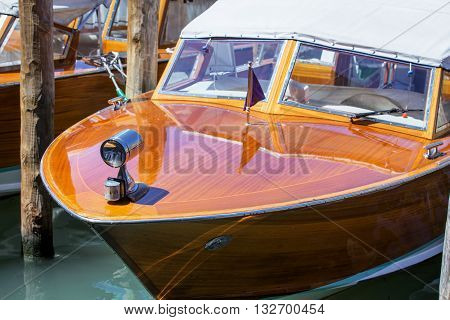 Venetian Taxa boat service in Canal Grande near Rialto Bridge