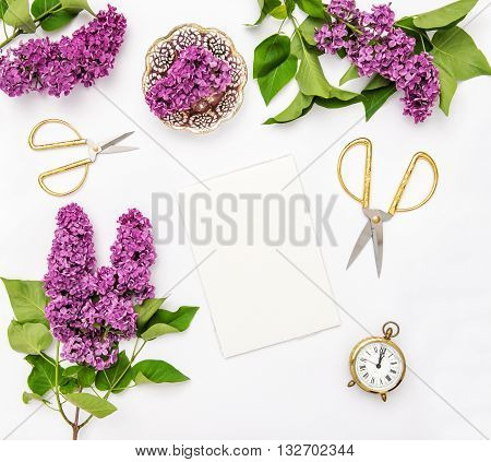 Sketchbook lilac flowers office tools and accessories. Flat lay notebook top view
