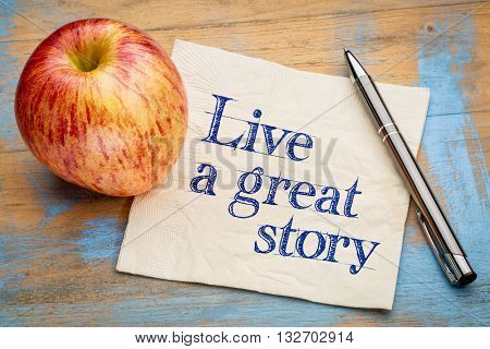 Live a great story - handwriting on a napkin with a fresh apple