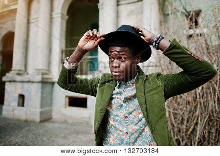 Close Up Fashion Portrait Of Black African American Man On Green Velvet Jacket And Black Hat, Backgr