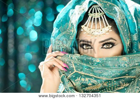 Portrait of a beautiful ethnic indian asian woman in pretty makeup and jewellery