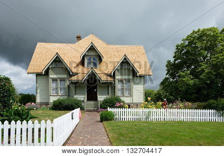 All American farm house with white picket fence