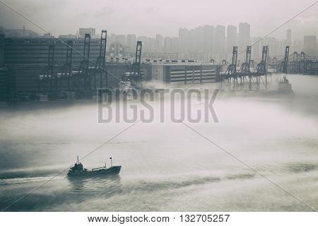 Hong Kong cargo port in mist