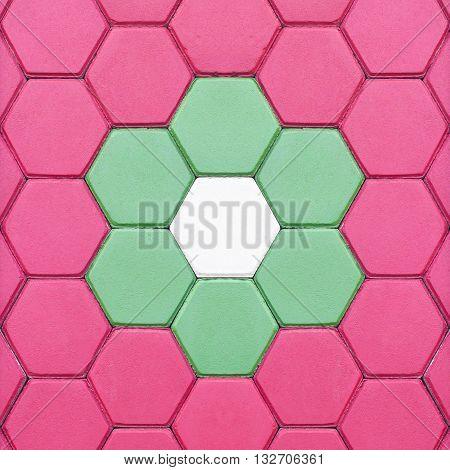 The Hexagonal brick flooring background. The pattern of stone block paving
