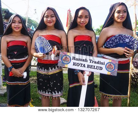 Penampang,Sabah-May 30,2016:Happy girls from Rungus Kota Belud,Sabah,Borneo ethnic in their traditional costume during Sabah Harvest festival celebration in Kota Kinabalu, Sabah Borneo, Malaysia.
