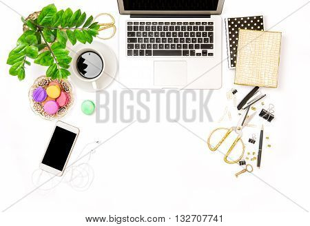 Office supplies and laptop. Creative business still life. Coffee and macaroon cookies. Flat lay