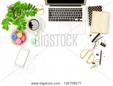 Workplace for business lady. Office supplies and laptop. Creative working. Coffee and macaroon cookies. Flat lay