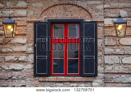 facade of the building , the window a red- black, vintage brick wall