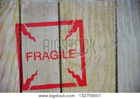 Red fragile stenciled on shipping packing crate