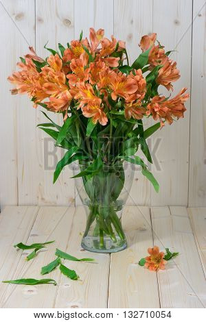 Bunch of beautiful alstroemeria flowers on wooden rustic background