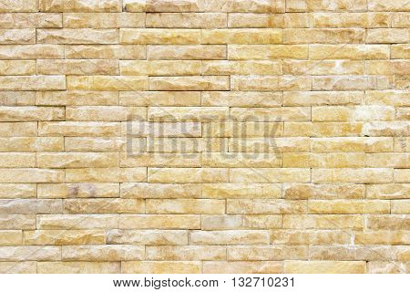 texture of the old sandstone wall for backgroundSandstone wall backgroundPattern of Sandstone Brick Wall Surfaced