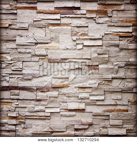 texture of the stone wall for backgroundSandstone wall backgroundPattern of Sandstone Brick Wall Surfaced