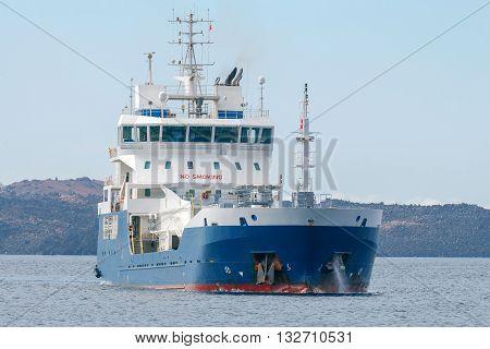 Small tanker on the raid of the island Santorini. Greece.