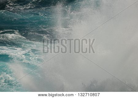 Pacific Ocean waves crashing against the rocks.