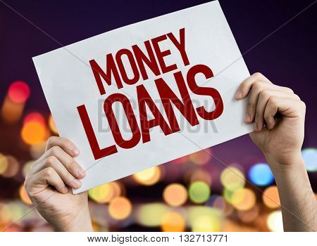 Money Loans placard with night lights on background