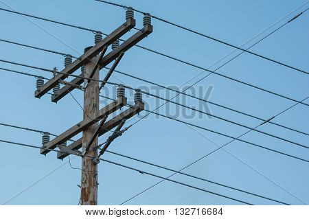 Utility pole with power and phone lines coming across