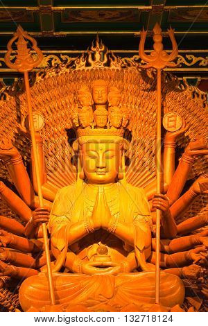 Thousand hands of god image make of wood carving in chinese temple Thailand