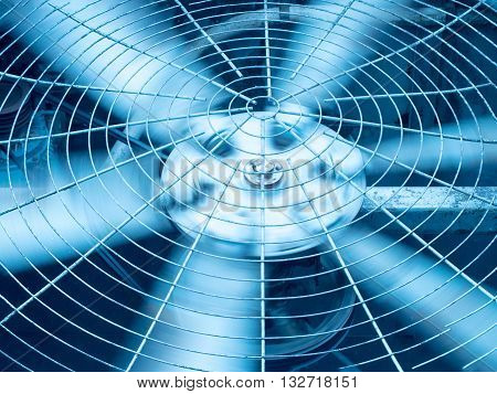 Blue tone of HVAC (Heating Ventilation and Air Conditioning) spining blades / Closeup of ventilator / Industrial ventilation fan background / Air Conditioner Ventilation Fan / Ventilation system