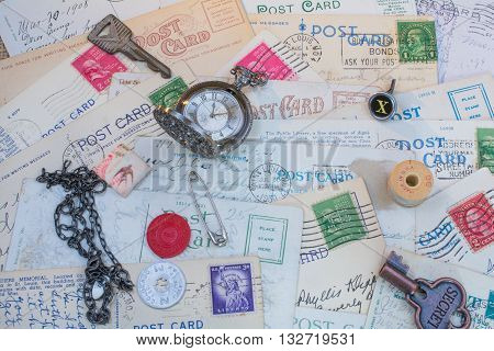 Old postcards, watches and vintage items scattered for background