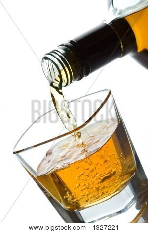 Double Whiskey Being Poured Into A Glass
