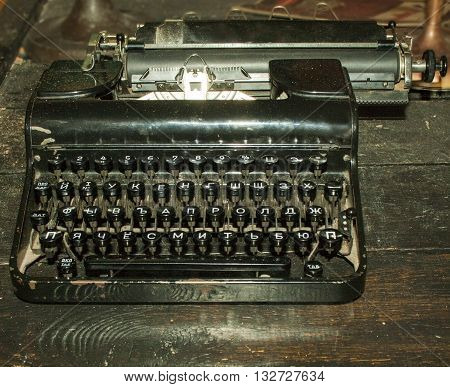 Vintage typewriter on an old wooden table