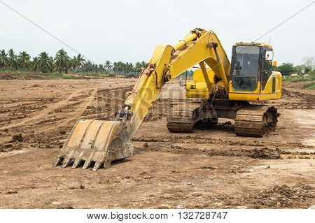 The big yellow excavator at quarry site.