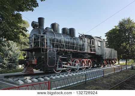 SLOVIANSK UKRAINE - AUGUST 1 2010: Steam locomotive - a museum piece near Sloviansk locomotive depot. With this locomotive driver Petro Krivonos set traffic records in the 30-ies of XX century