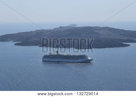 SANTORINI GREECE - AUGUST 3 2013: Cruise ship off the coast of Santorini. Santorini - one of the most visited places in Greece